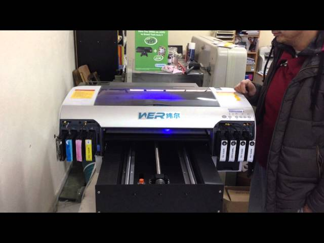 Spiros Tolios from Greece , WER-D4880UV desktop uv printer with free RIP  software and installation